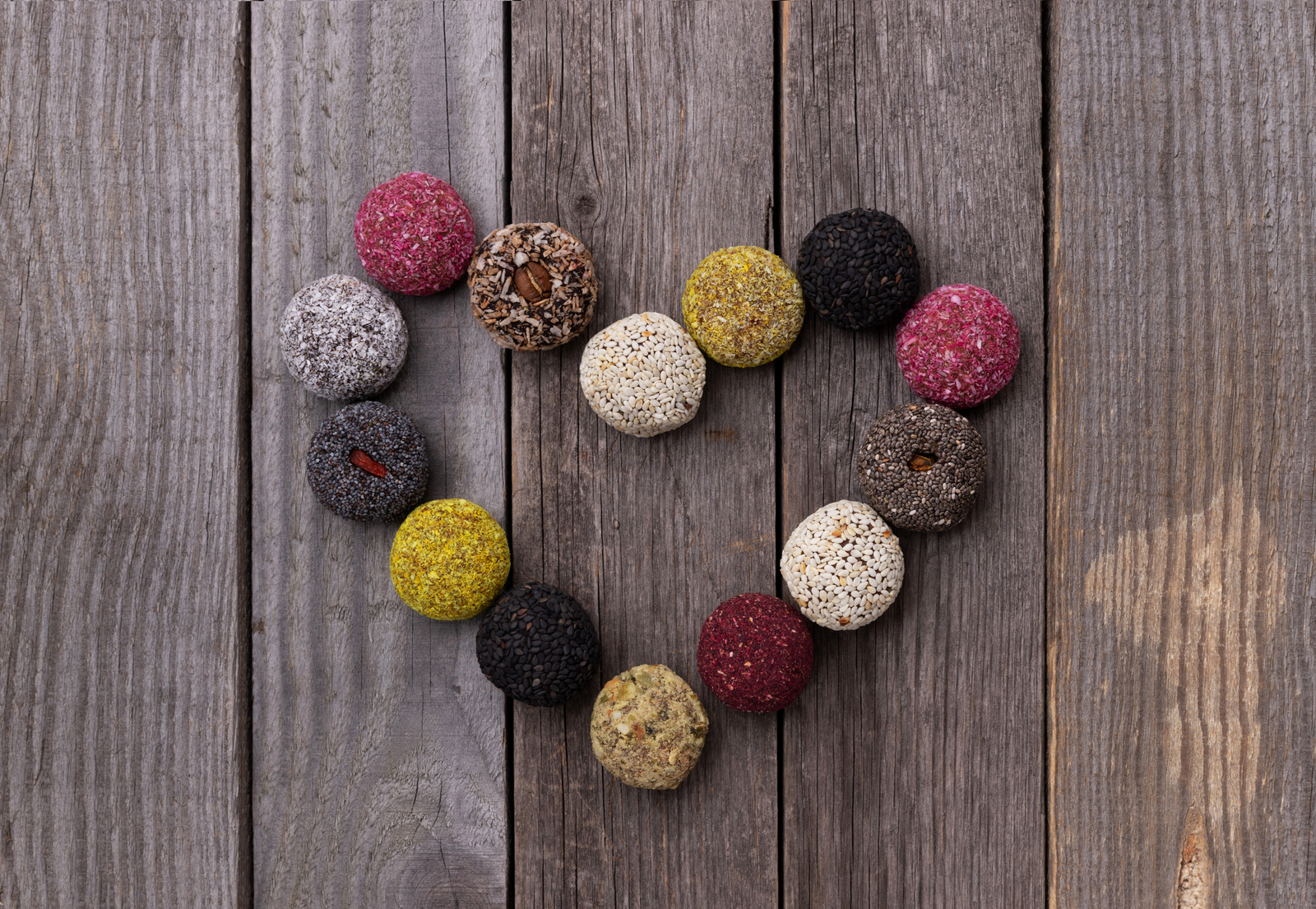 2-raw-energy-bites-balls-heart-shape-old-rustic-wooden-background.jpg