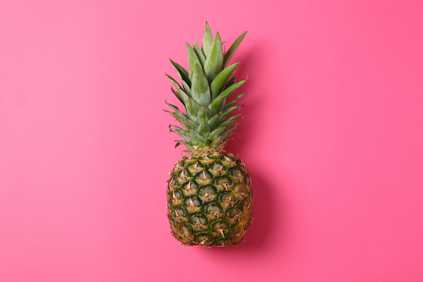 1-pineapple-pink-background-space-text-juicy-fruit.jpg